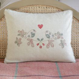 Handmade cushion. Light grey cotton base with applique lovebird detail and linen piped edge