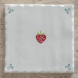 hand made and hand painted strawberry design tile