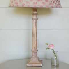 Handmade wooden stick lamp base hand-painted in a whitewash finish.
